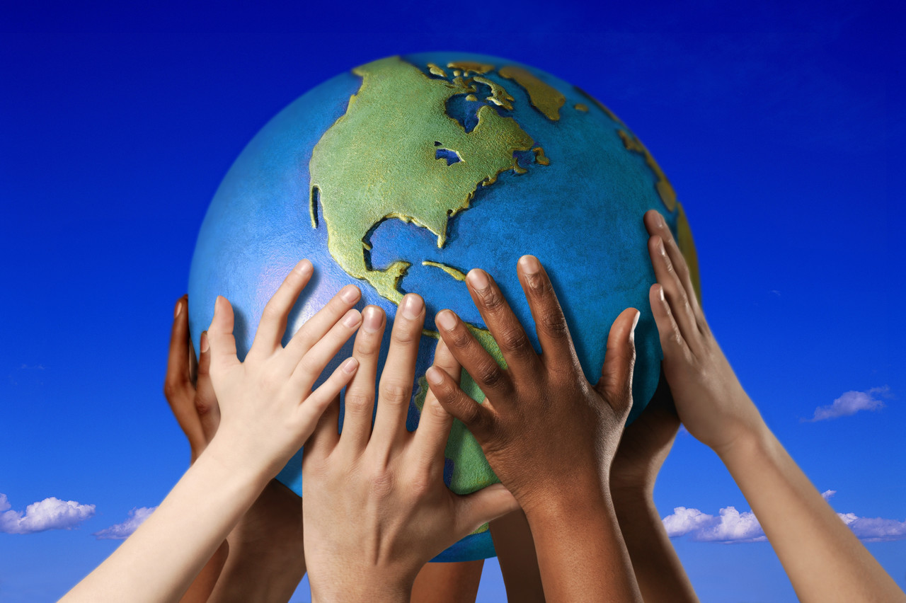 Hands on a globe --- Image by © Royalty-Free/Corbis
